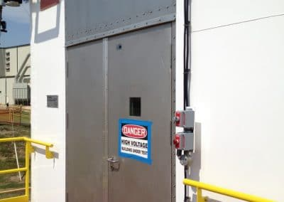 Double hinged blast door with toppanel